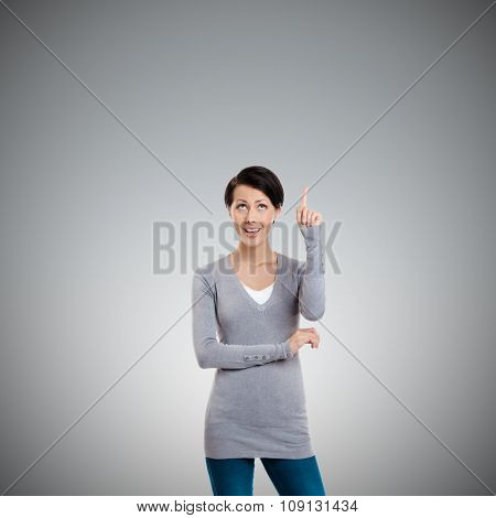 Pointing up hand gesture, isolated on grey