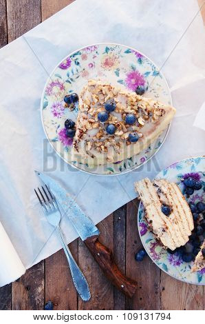 Slice of delicious cake with fresh blueberry on wooden backgroup. Piece of blueberry cake, piece of