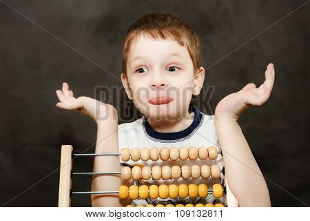 Boy In Surprise Spread His Arms Near The Wooden Abacus.