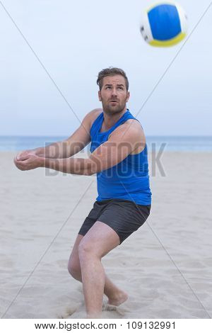 Male Player Playing Beach Volleyball.