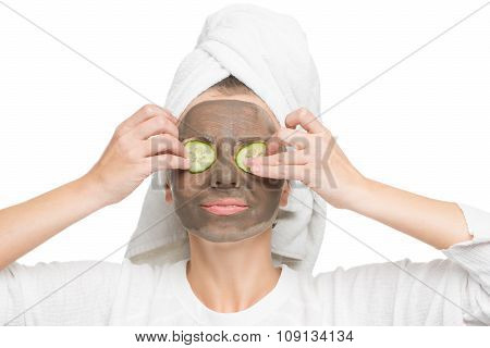 Young beautiful woman in mask for the face. therapeutic black clay. Spa treatment.