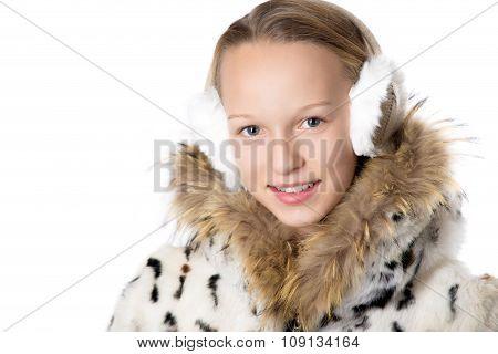 Girl In Furry Coat And Earmuffs