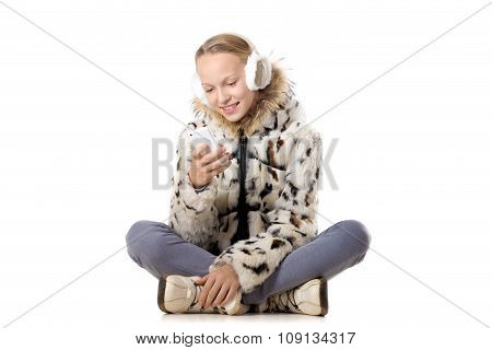 Happy Girl In Winter Outfit Using Mobile Phone
