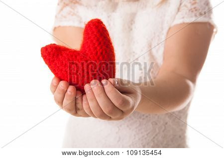 Red Knitted Heart In The Hands Of Children, The Concept Of Valentine's Day, White Background