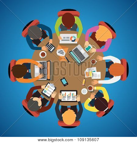 Eight people team sitting and working together