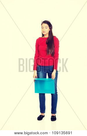 Exhausted student woman holding blue folder.