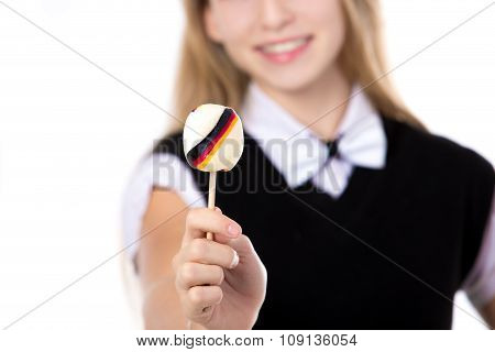 Smiling Girl Showing Candy With Germany Flag
