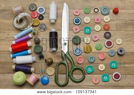 Full Sewing Kit On Wooden Backgrounds