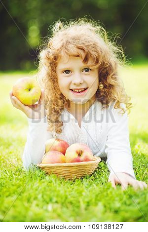 Child Is Eating Red Apple