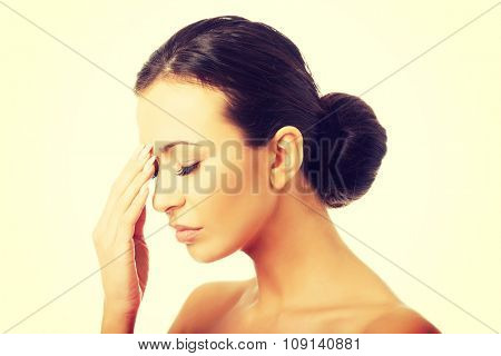 Stressed spa woman with eyes closed.