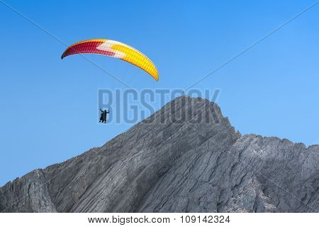 Paraglider Free Soaring In Cloudless Sky Over Dolomites Alpine Mount
