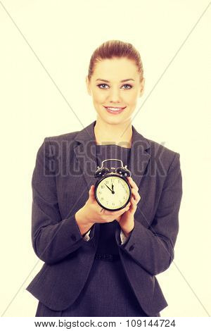 Happy businesswoman with a clock.