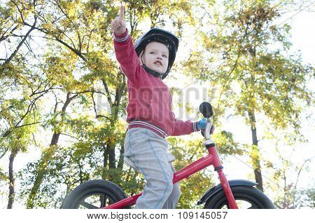 boy riding a bike in the park