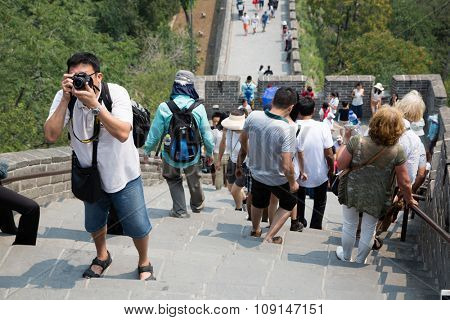 BEIJING - CIRCA JUNE, 2015: Many tourists up and down the steps of the Great Wall of China. Great Wall of China It passes through China, is the longest man-made structure in the world.