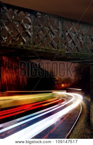 Train light trails on Great Western Railway at night