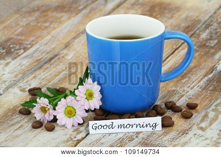 Good morning card with mug of coffee, pink daisies with copy space