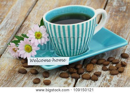 Welcome home card with cup of coffee and pink daisy flowers