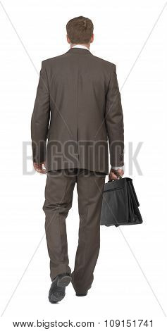 Businessman with suitcase walking