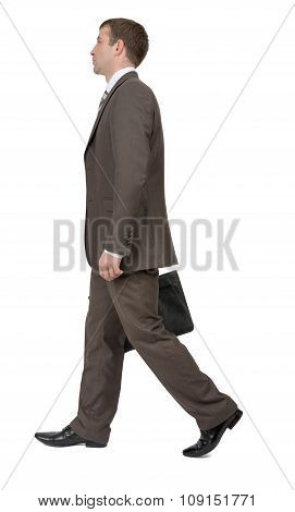 Businessman with suitcase, side view