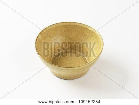 Empty beige bowl on white background