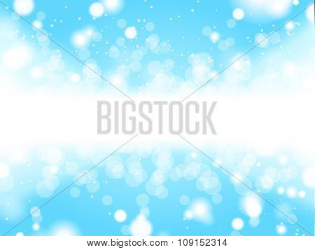 Winter lights and snowflakes with space for text