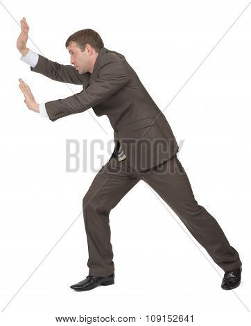 Businessman pushing empty space