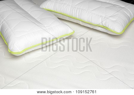 Closeup Of Orthopedic Mattress And Pillows