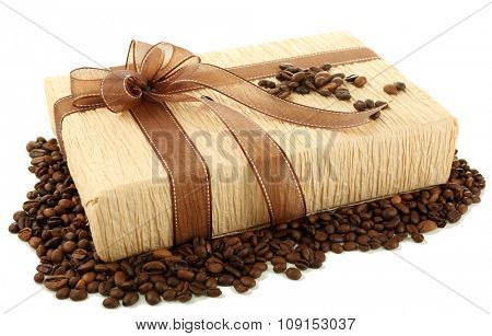 Beautiful gift with bow and coffee grains isolated on white