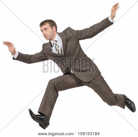 Businessman in suit running