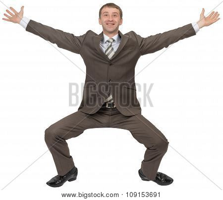 Happy businessman sitting on empty space