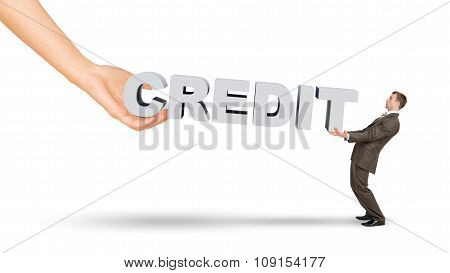 Businessman and hand holding word credit