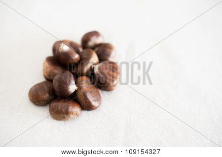 Raw Whole Brown Chestnuts Heap