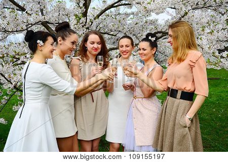 Girls With Champagne Celebrating In Sakura's Garden.