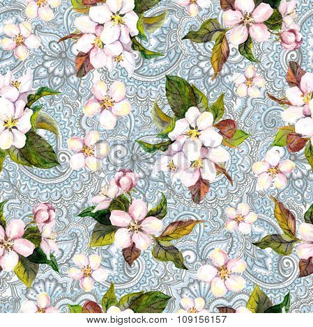 Floral repeating pattern with flowers and indian ornamental paisley design. Sakura on ornamental bac