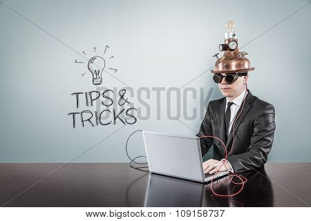 Tips and tricks concept with vintage businessman and laptop
