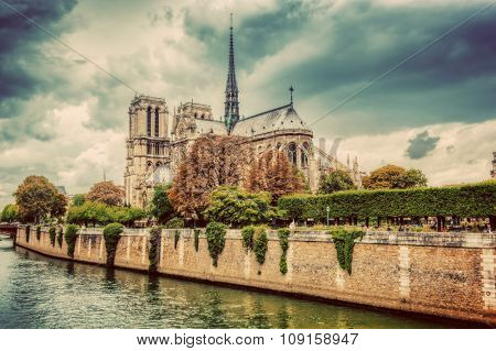 Notre Dame Cathedral in Paris, France and the Seine river. Moody clouds