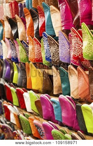 Colorful slippers displayed at market stall at Marrakesh souk