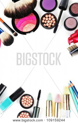 Frame of decorative cosmetics on white background
