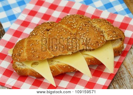 Sesame seed challah sandwich with cheese