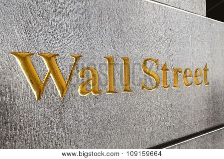 Wall Street Golden Inscription On A Building Gray Stone Wall.