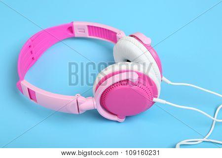 Headphones on blue background