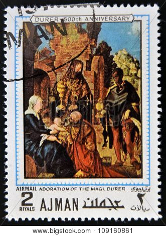 AJMAN - CIRCA 1970: a stamp printed in Ajman shows Adoration of the Magi Painting by Albrecht Durer