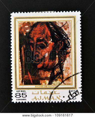 AJMAN - CIRCA 1970 A stamp printed in Ajman shows Dali portrait by Alexander Rutsch circa 1970