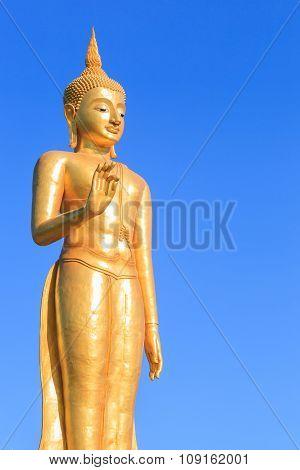Gold Buddha Statue On Blue Sky