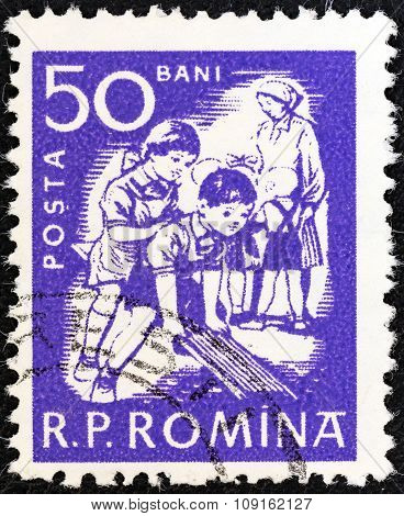 ROMANIA - CIRCA 1960: A stamp printed in Romania shows children at play