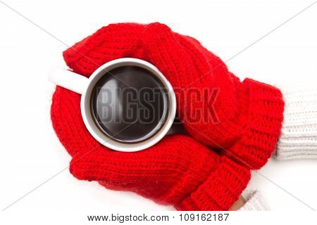 Woman In Knitted Mittens Holding A Cup Of Coffee