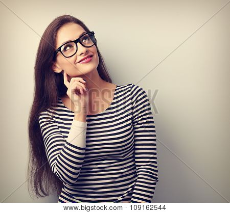 Pretty Casual Thinking Woman In Glasses Looking Up. Toned Portrait