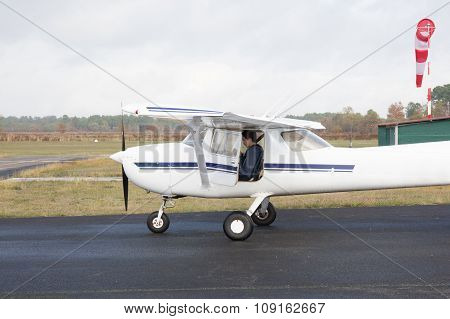 Small Airplane Standing At The Runway