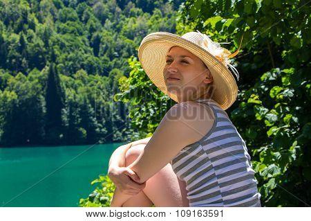 Sitting woman tourist looking away