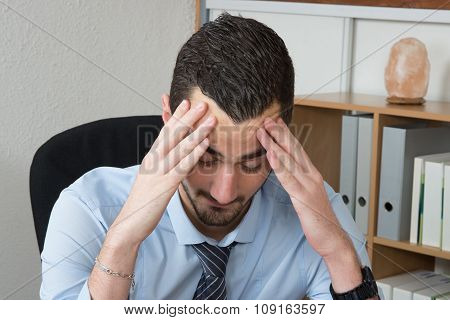 Stressed And Tired. Depressed Young  Man In Formalwear Holding Head In Hands.